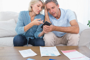 bigstock-Worried-couple-going-over-thei-47916218